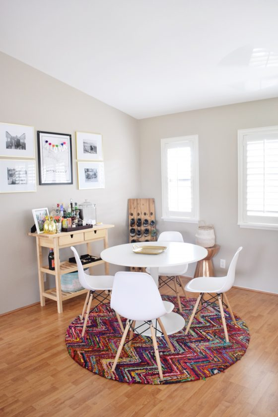 Mid-Century Modern Dining Room - Colorful Dining Room - EAMES Chairs - Wayfair Rug - Honolulu Map - Bar Cart - Hawaiian Home Feature on Apartment Therapy - CommuniKait