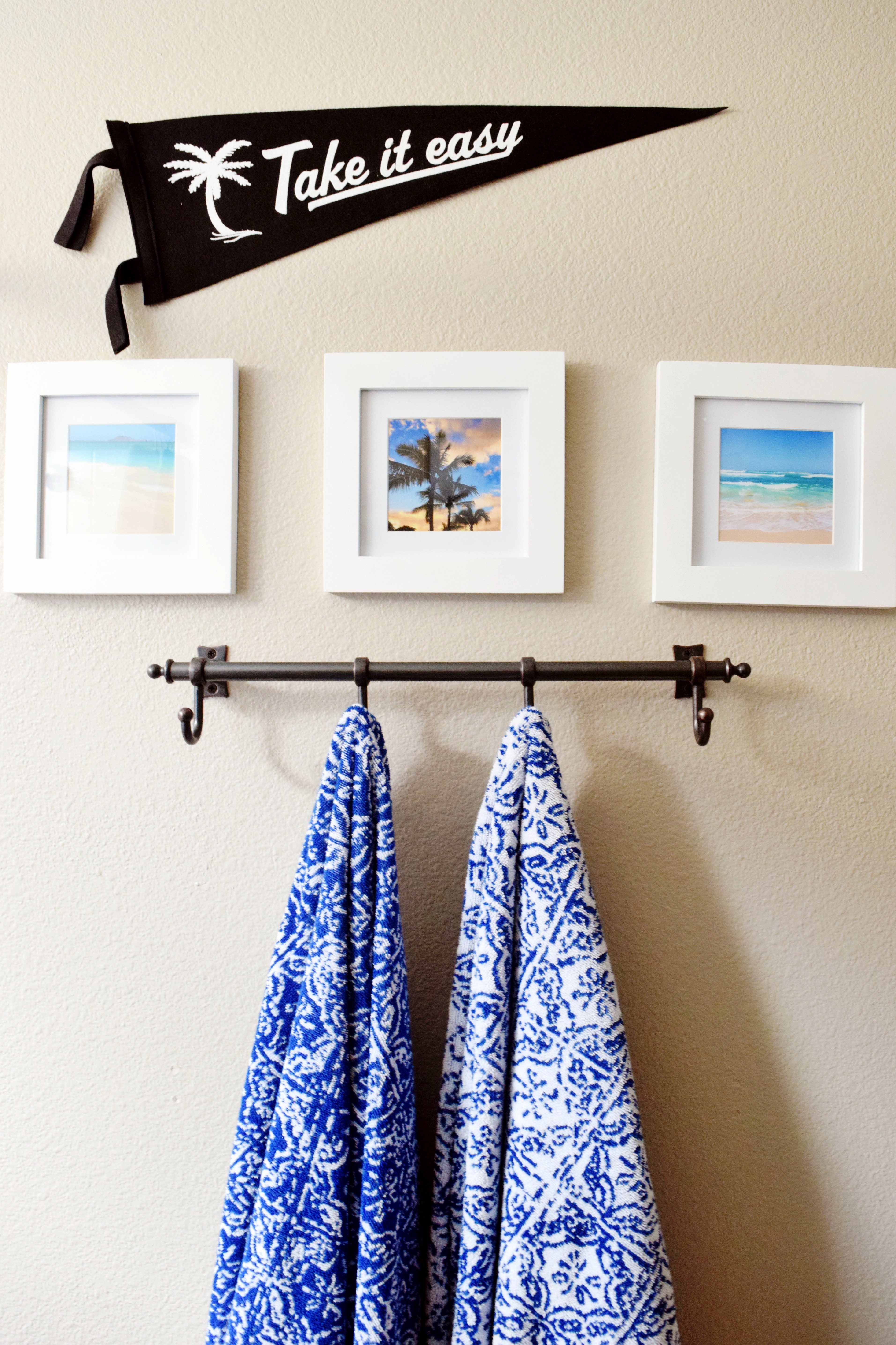 Bathroom Details - Take It Easy Pennant - Instagram Frames - Blue and White Towels - Hawaiian Home Feature on Apartment Therapy - CommuniKait