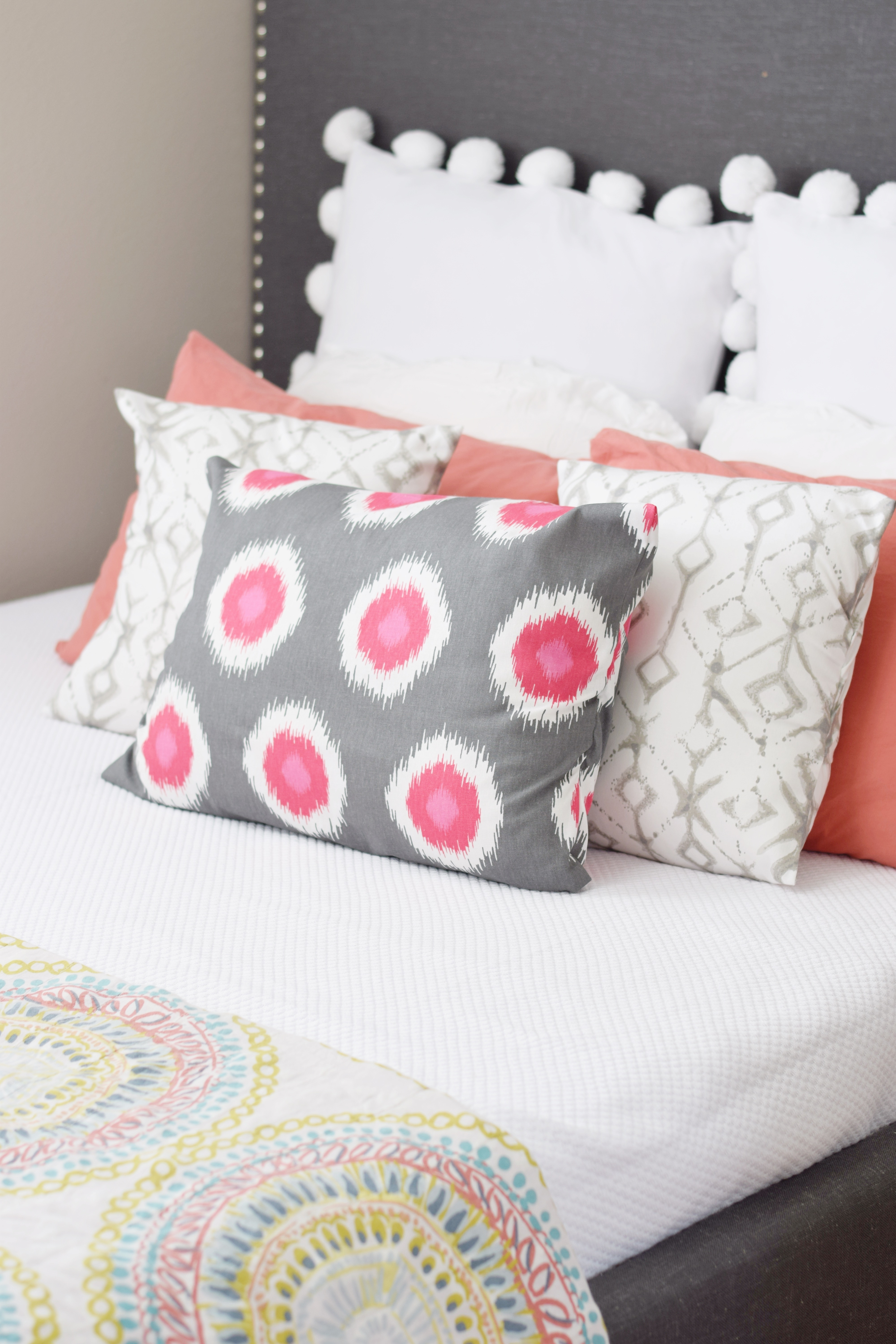 Tropical Guest Bedroom - Pom Pom Pillow - Pink Polka Dot Pillow - Grey Headboard - Hawaiian Home Feature on Apartment Therapy - CommuniKait