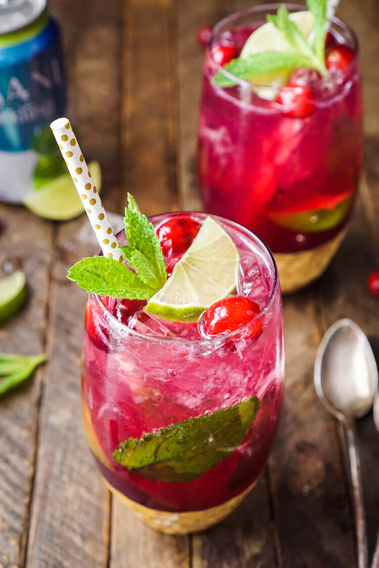 Cranberry Mojito Punch - - 12 Festive Cocktails For Any Holiday Occasion - Communikait by Kait Hanson