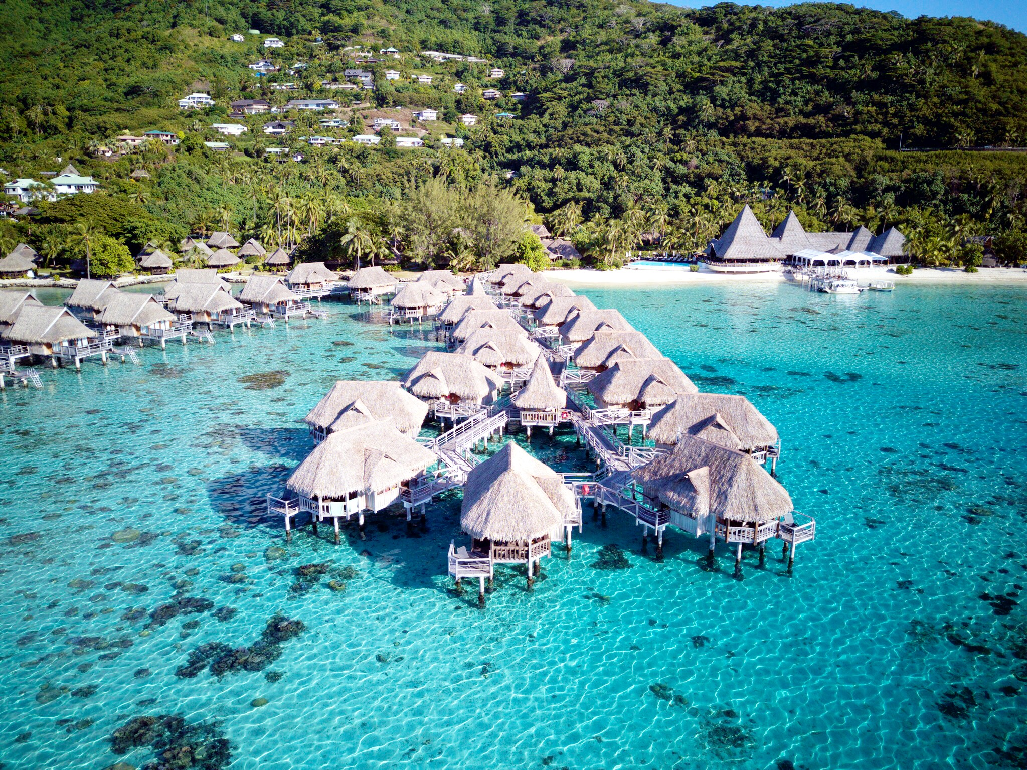 21 Drone Photos of Overwater Bungalows In Tahiti - Overwater bungalows - overwater bungalows caribbean - Overwater bungalows Mexico - Bora Bora Overwater Bungalows - Hotels With overwater bungalows - water bungalows - huts over water - overwater bungalow vacation - overwater bungalow vacation - Tahiti Honeymoon - Honeymoon Trip Ideas - Communikait by Kait Hanson #overwaterbungalows #honeymoon #tahiti #frenchpolynesia #moorea #borabora #tahaa #bestresorts