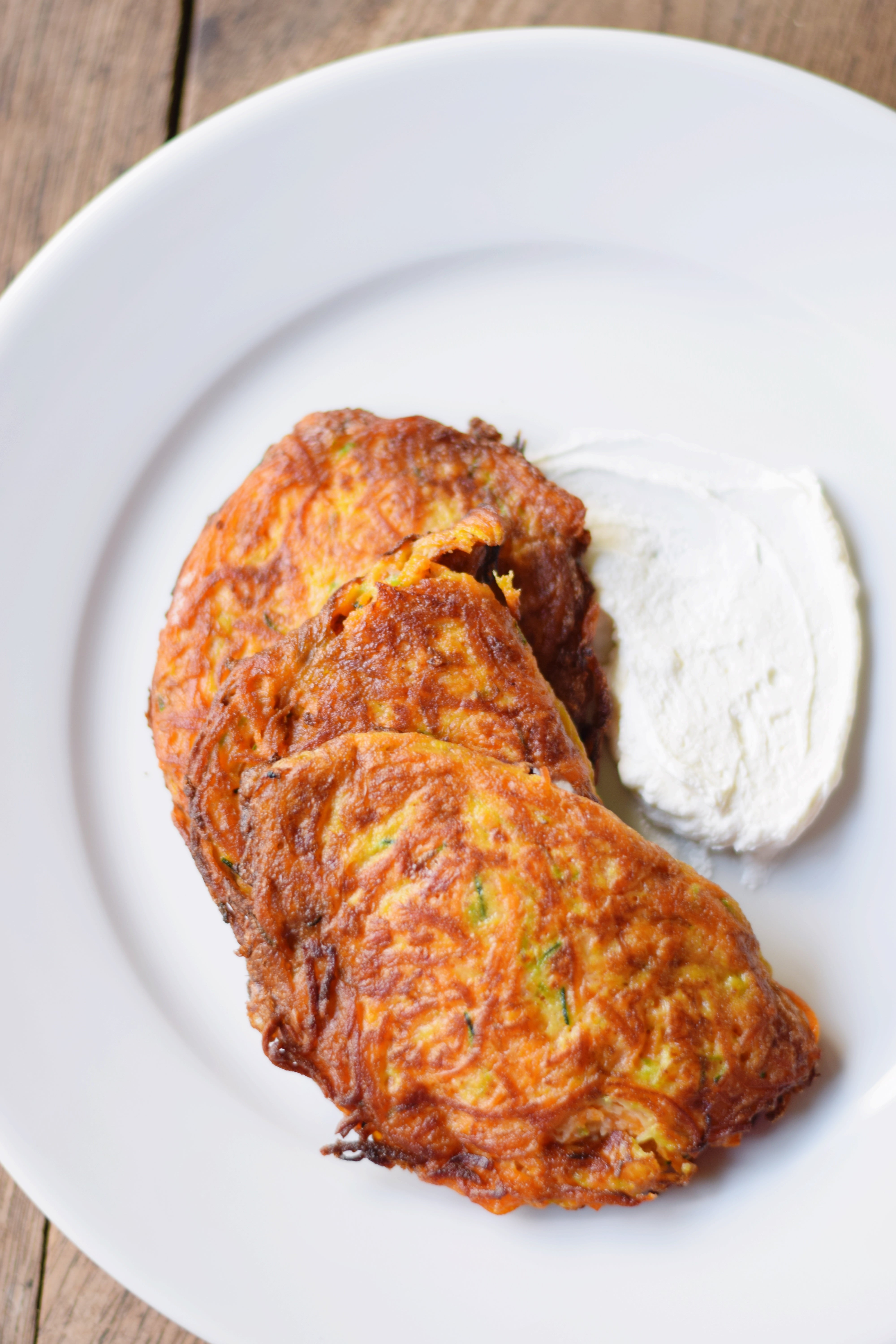 ZUCCHINI + SWEET POTATO FRITTERS WITH GOAT CHEESE | Zucchini Fritters - Sweet Potato Fritters - Vegetarian Snack - Zucchini Fritters Recipe - Best Zucchini Fritters - Le Jardin Marrakech - Green Giant Veggie Spirals - Vegetarian Meals - Recipes With Goat Cheese - #vegetarian #veggiespirals #recipe