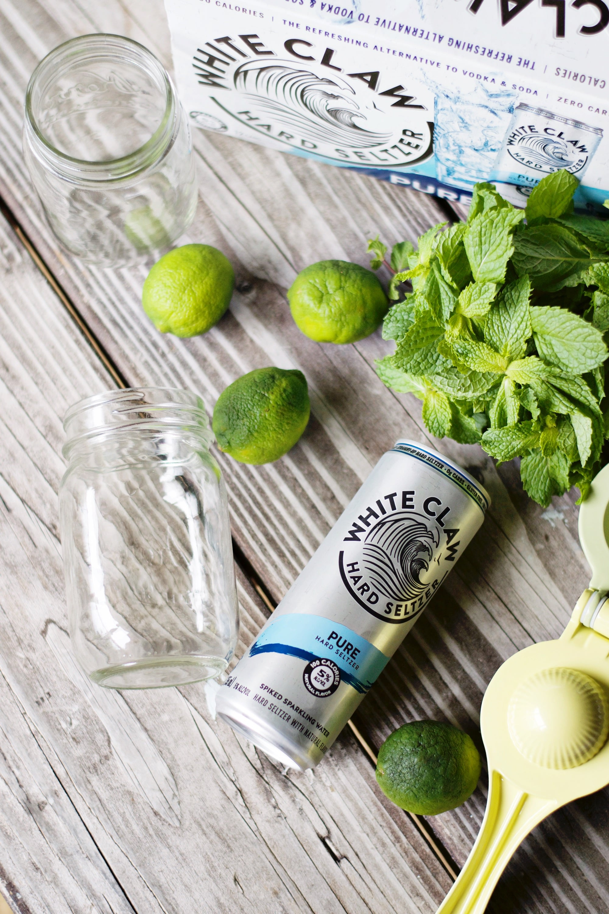 Mango Lime Spritz - An easy and light mango cocktail made with White Claw Pure Hard Seltzer and infused with lime and mint! | White Claw Hard Seltzer Cocktails - Spiked Seltzer cocktails - Mango Cocktails - Summer Cocktails - Easy Summer Cocktail Recipes - Lime and Mint Cocktail