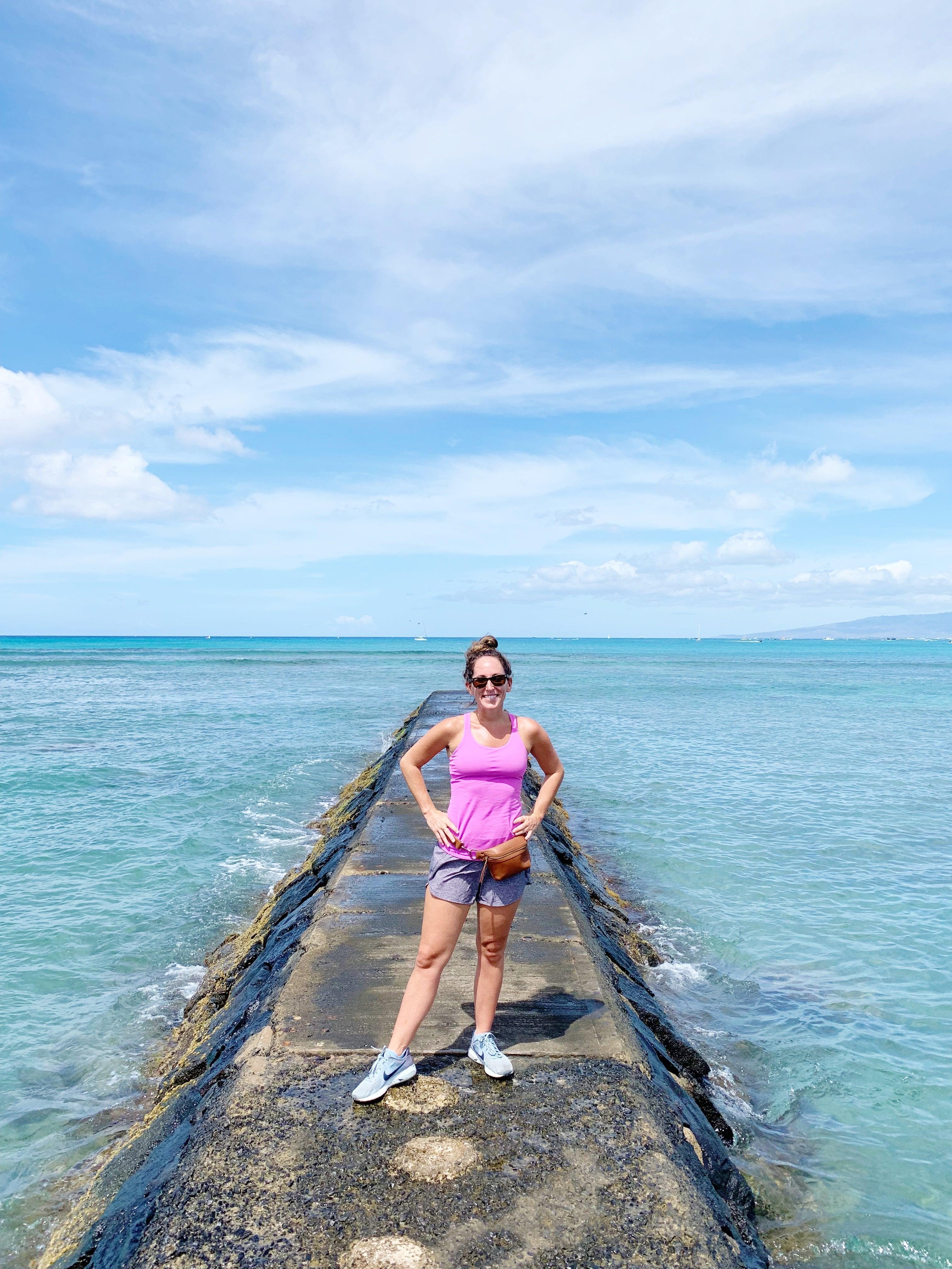 Girl standing on pier in Waikiki