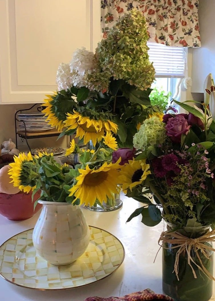 Sunflowers and hydrangea in vases