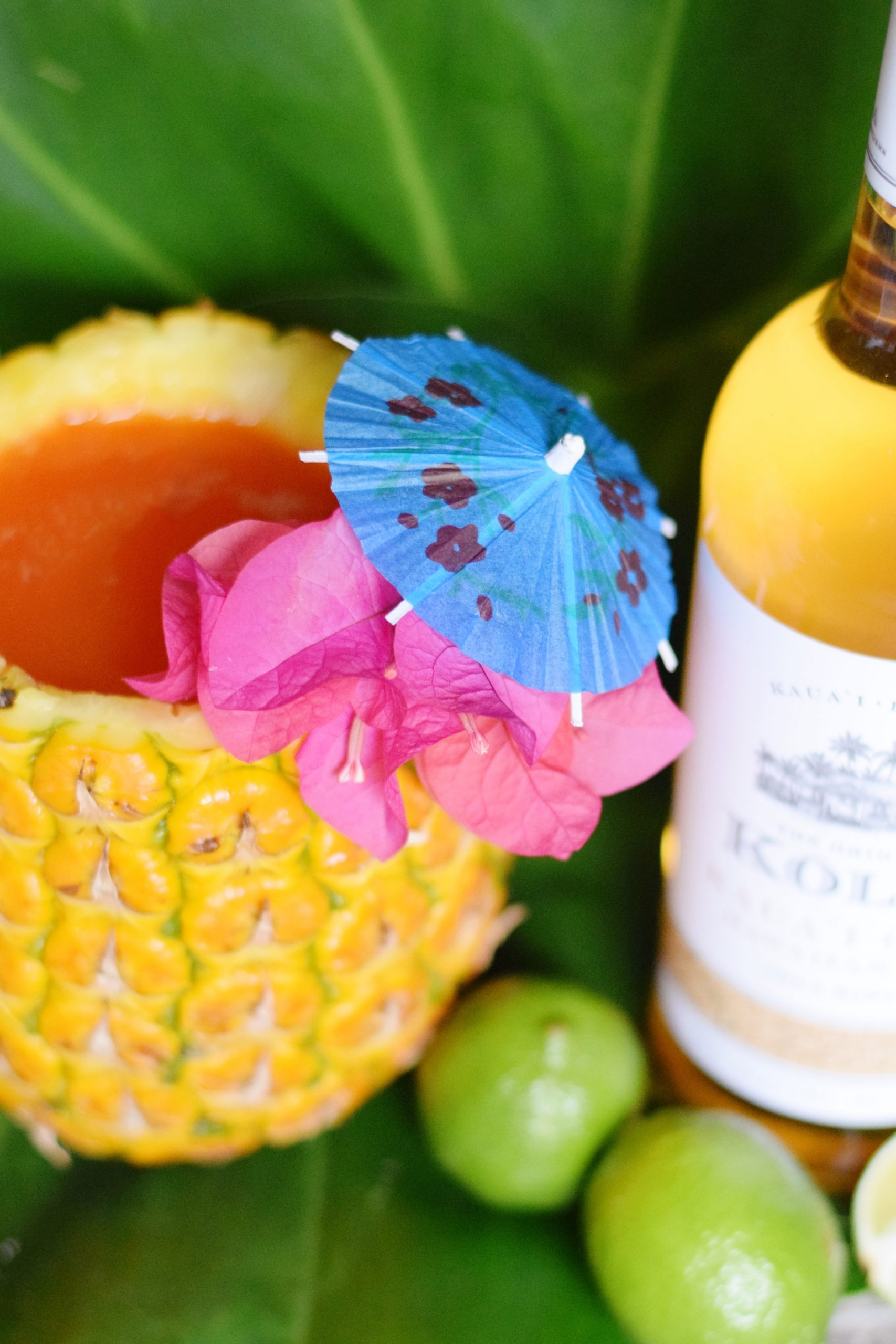 Pacific Painkiller Cocktail With Kōloa Rum - A delicious mix of tropical juices and three types of Kōloa Rum, makes this the ultimate painkiller cocktail recipe! - Painkiller Cocktail Recipe - Painkiller Cocktail - Kōloa Rum - Kōloa Rum cocktail idea - Hawaii Tropical cocktail - Cocktail served in a pineapple
