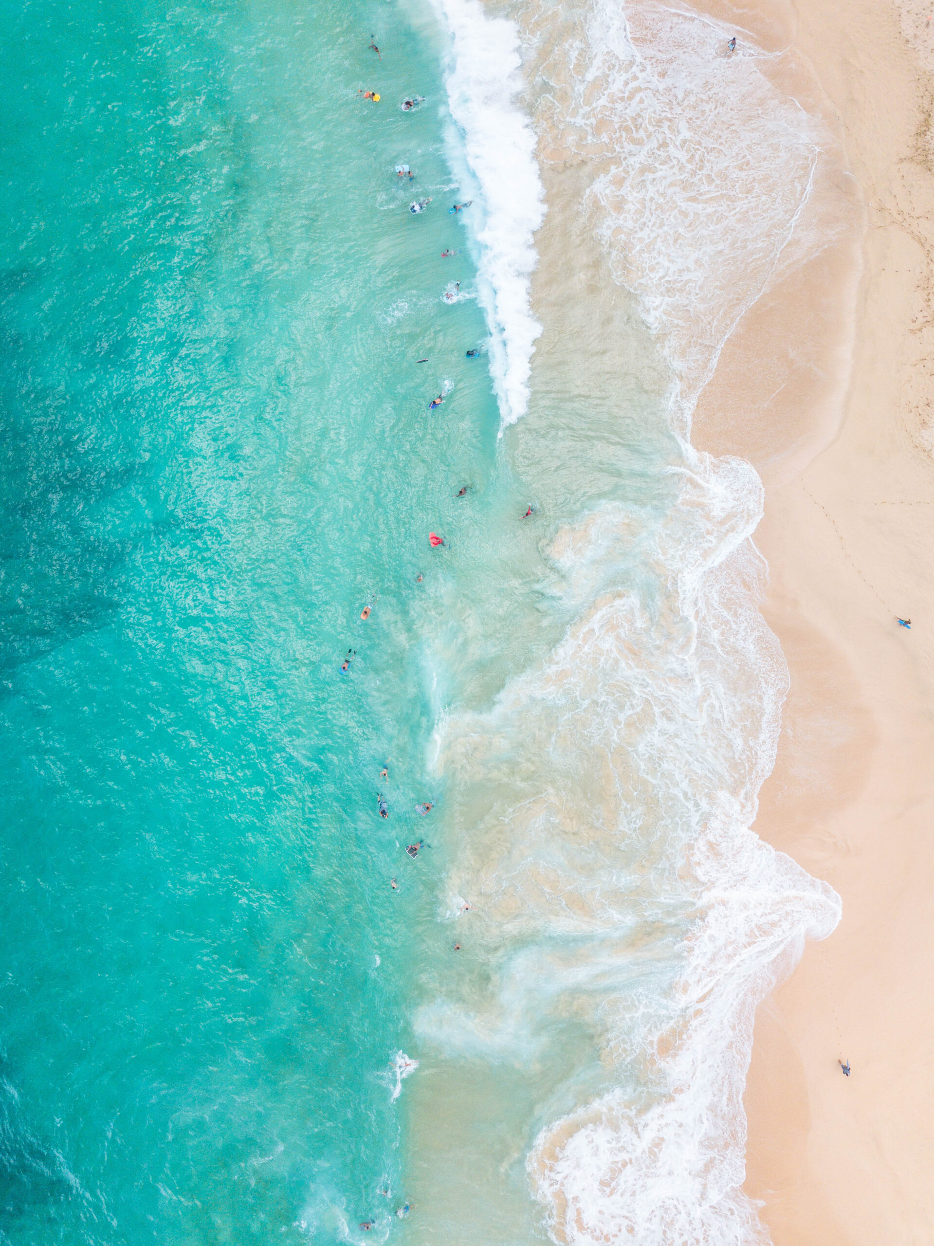 Aerial of Hawaii beach with turquoise water and sad