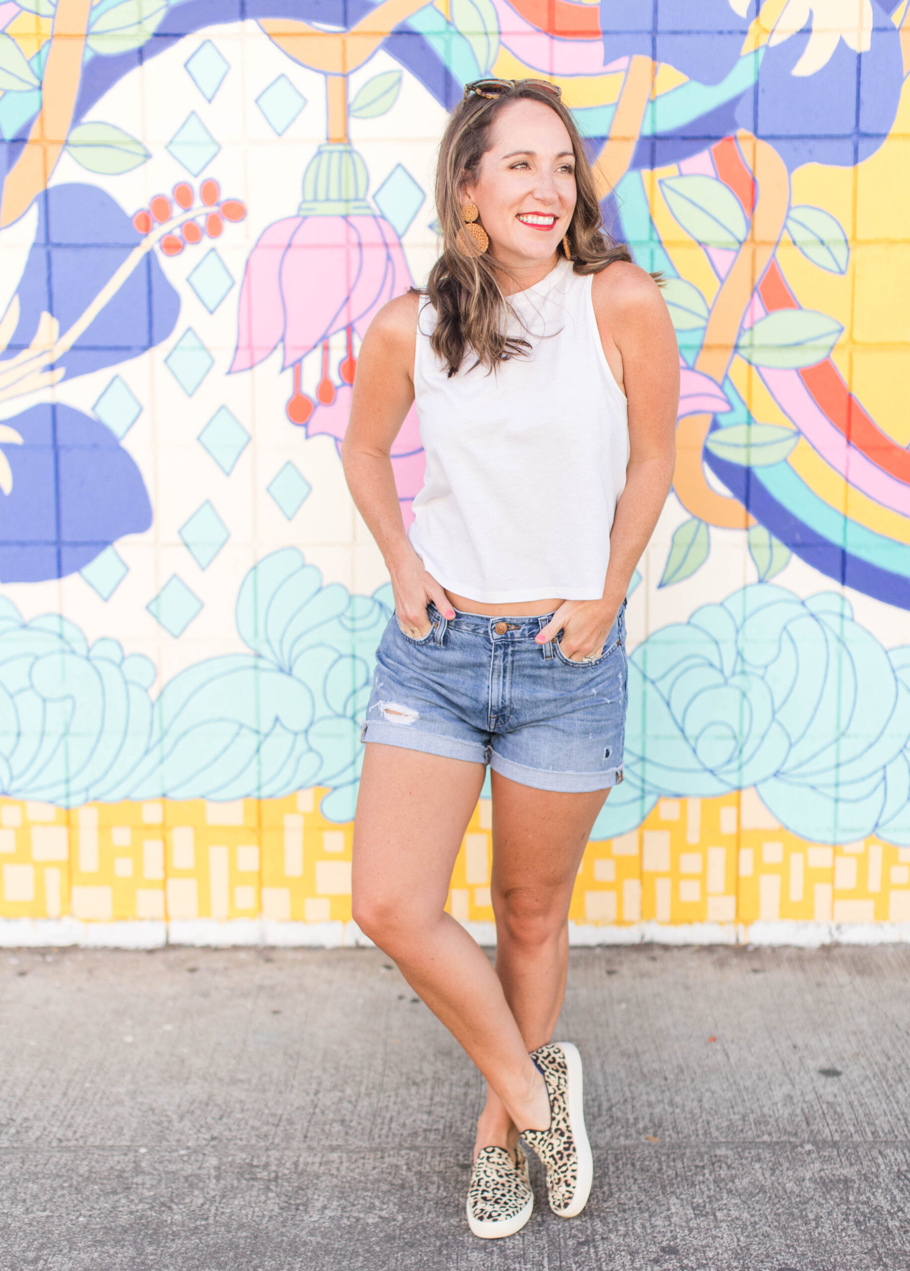 Rothy's sneakers with denim shorts and a simple top