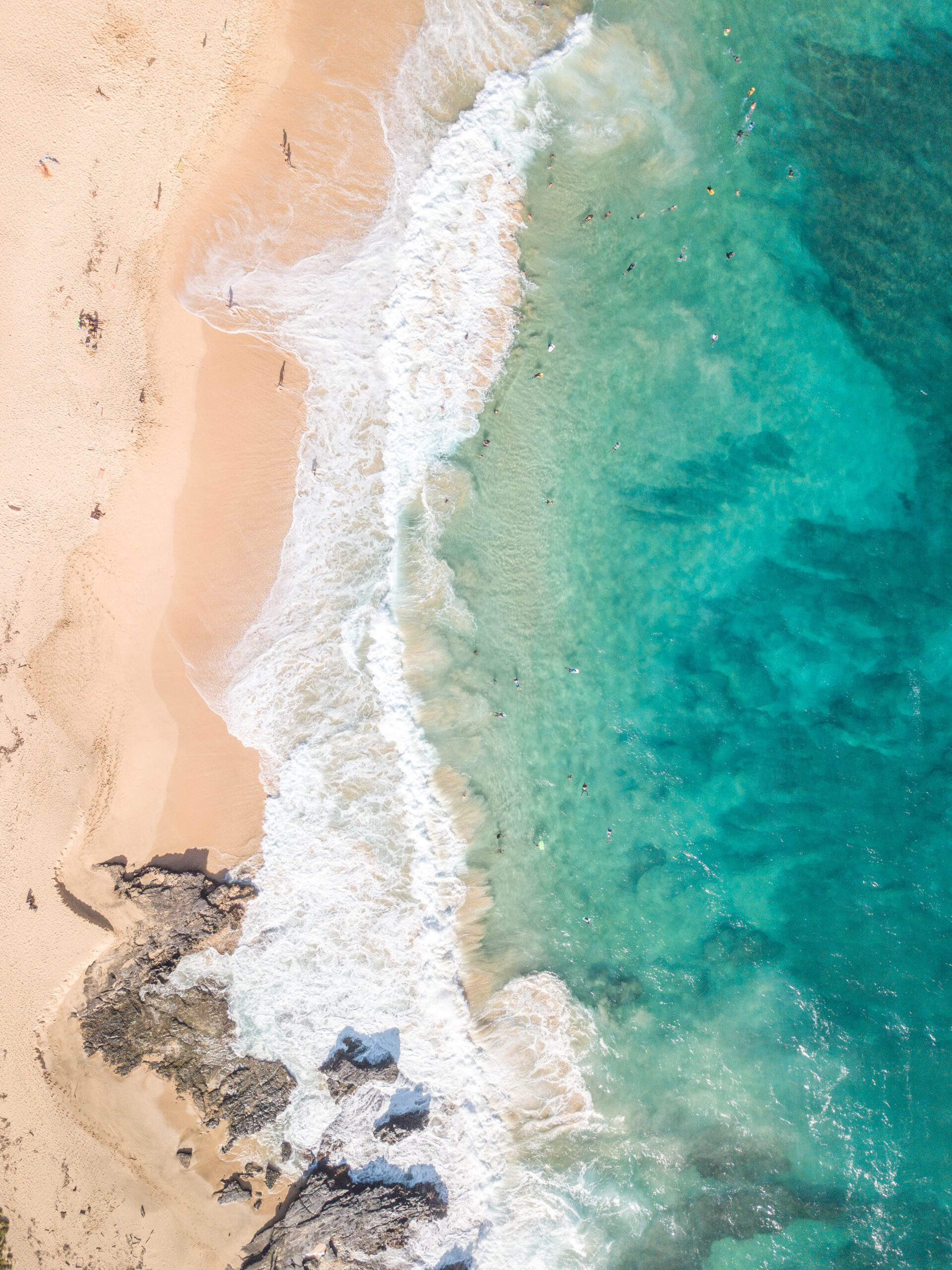 Aerial photo of white sand beach with turquoise water
