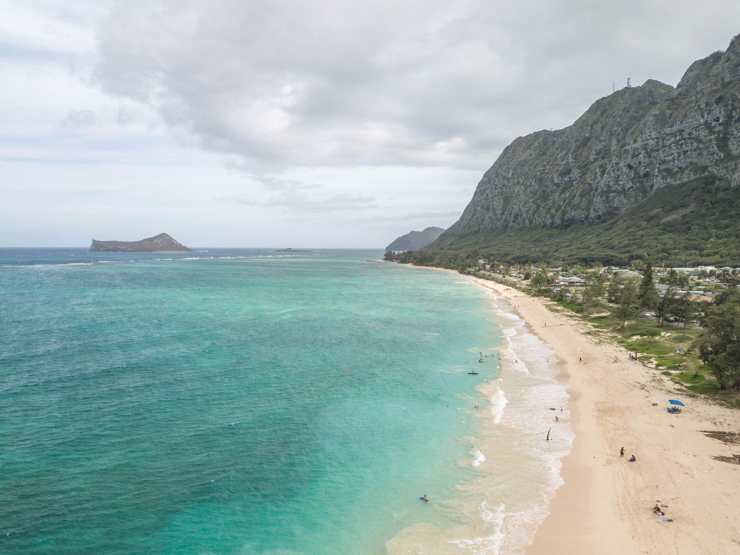 Waimanalo Beach Coastline - Turquoise ocean with white sand beach and mountain ridge coast