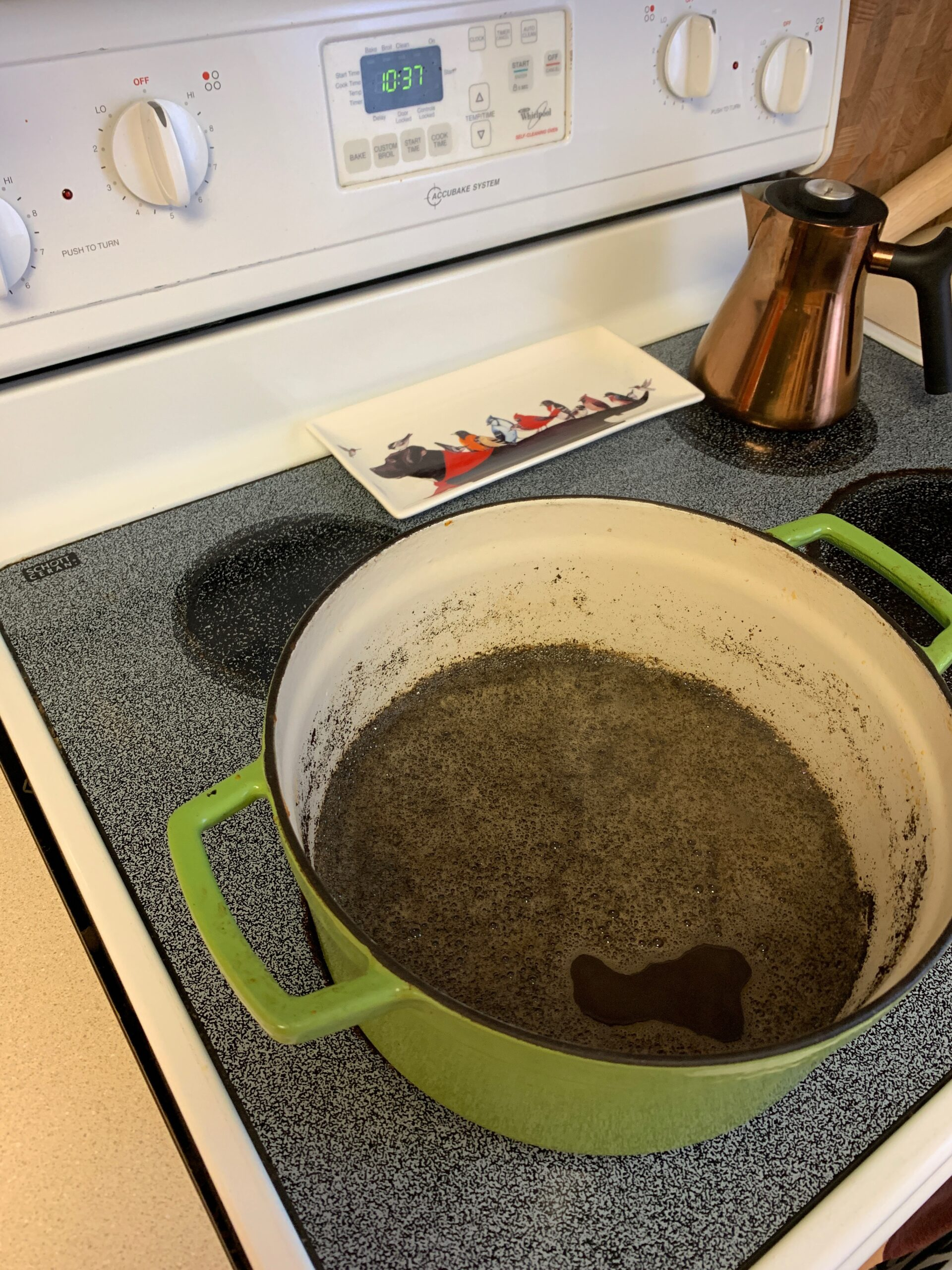 Cleaning enameled cast iron using hot water and baking soda